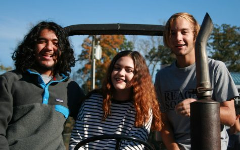 Juniors Jose Barrios and Andrew Burciu and sophomore Alexis Tadlock enjoy the various activities Ag Day has to offer.