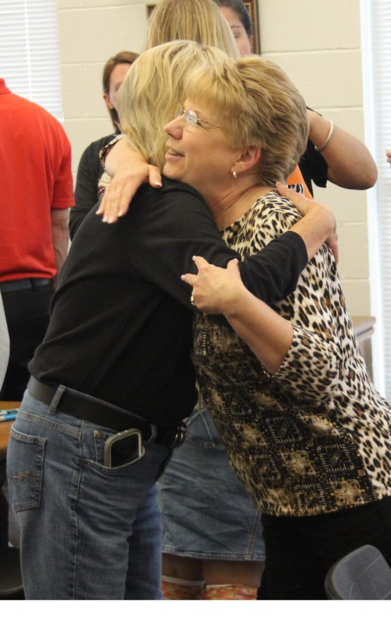Betty+Jo+Martin+embraces+a+faculty+member+on+her+last+day+at+Reagan.+Martin+retired+on+Oct.+31+after+11+years+at+Reagan.