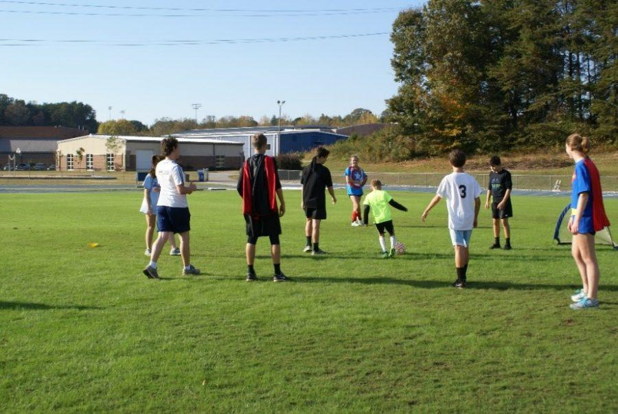A+participant+of+TOPSoccer+kicks+the+soccer+ball.++Volunteers+and+participants+play+mini+games+of+soccer.