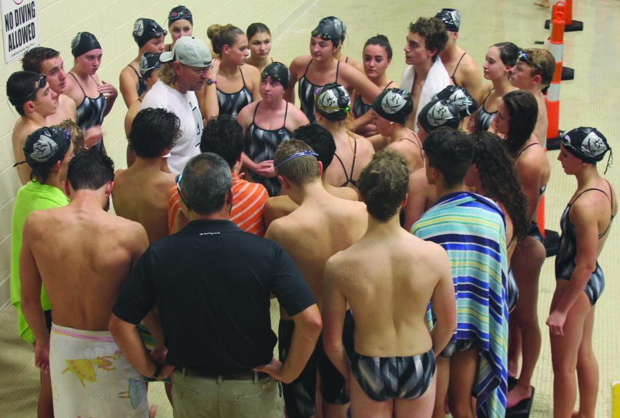 Reagans swim team huddles together before a big swim meet against West Forsyth and Tabor.  The Raiders were victorious over both teams.
