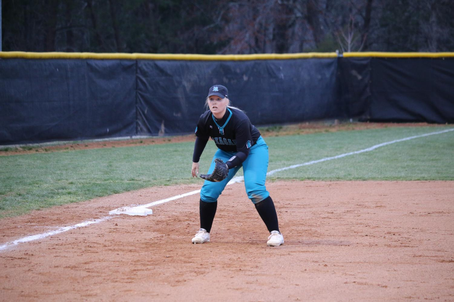 Senior Jessica Cummings prepares for a ground ball.  Cummings is one of the five seniors on the softball team.