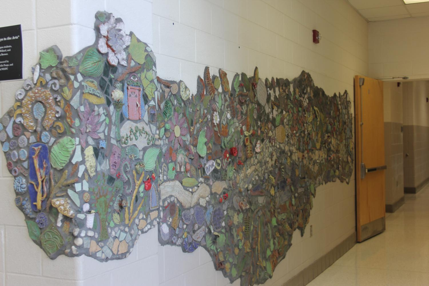 'Pathways and Portals to the Arts' displays themes of water, land, paths, greenery, and portals. The display was created by the art classes.