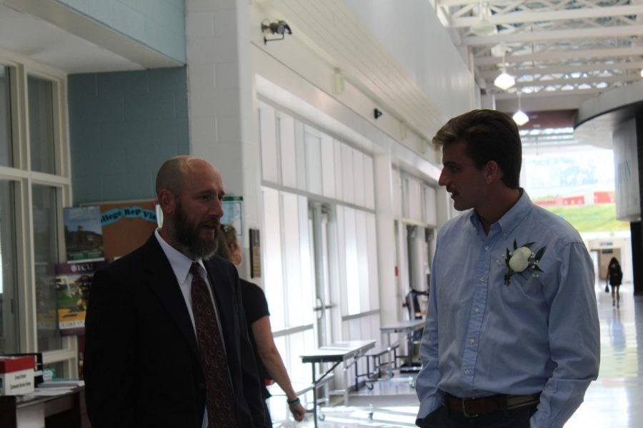 Inductee Craig Engels chats with current track and cross country Coach Eric Fritz.