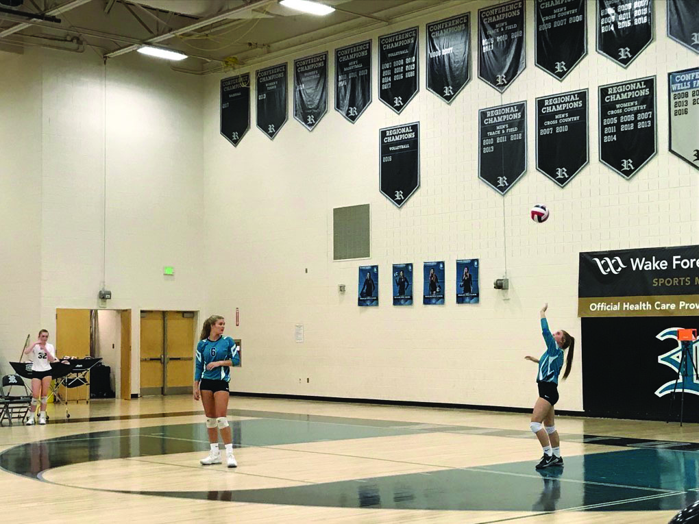 Varsity designated setter, Bailey Presley serves the ball against Northern Guilford.  Both Reagan teams defeated the Nighthawks on Sept. 24.