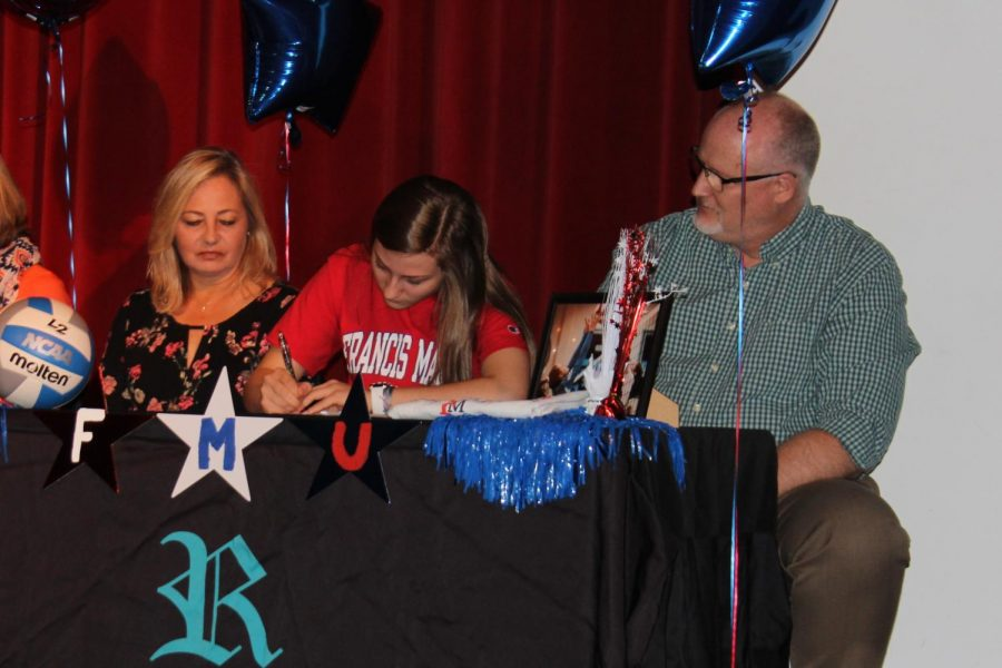 Madeline+Winning+signs+her+National+Letter+of+Intent+with+Francis+Marion+University.+Winning+is+a+member+of+the+girls+volleyball+team