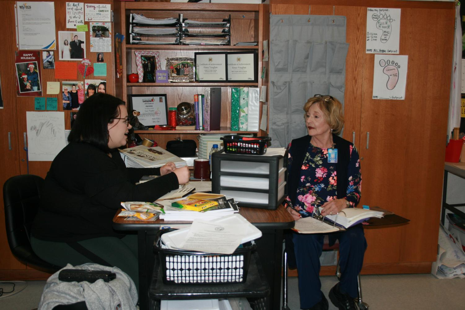 OCS teacher Grace Vaughan converses with mentor Dinah Reece. They meet frequently throughout the year to discuss progress and set goals for the classroom.