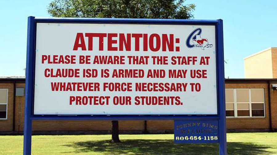 Posted sign at a high school to warn parents and students about armed teachers.