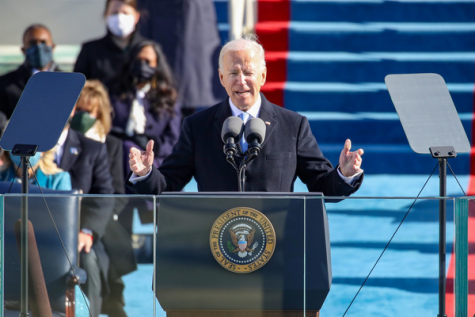 46th President Joe Biden addresses the nation at his inauguration ceremony. Biden was sworn into office by Supreme Court Justice John Roberts before his speech.