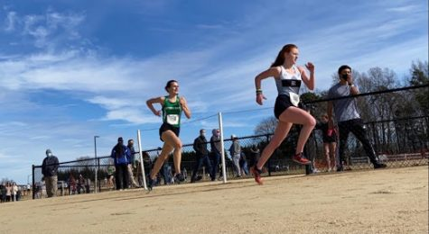 Junior Libby Marcantonio sprinting to the finish at the State Meet, where the girls team finished in 3rd.