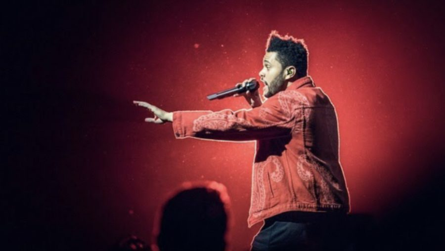 The+Weeknd+performed+at+the+55th+annual+Super+Bowl+on+Feb.+7th%2C+2021.+He+decided+to+sing+solo+this+year+to+keep+his+vision+intact.%0A