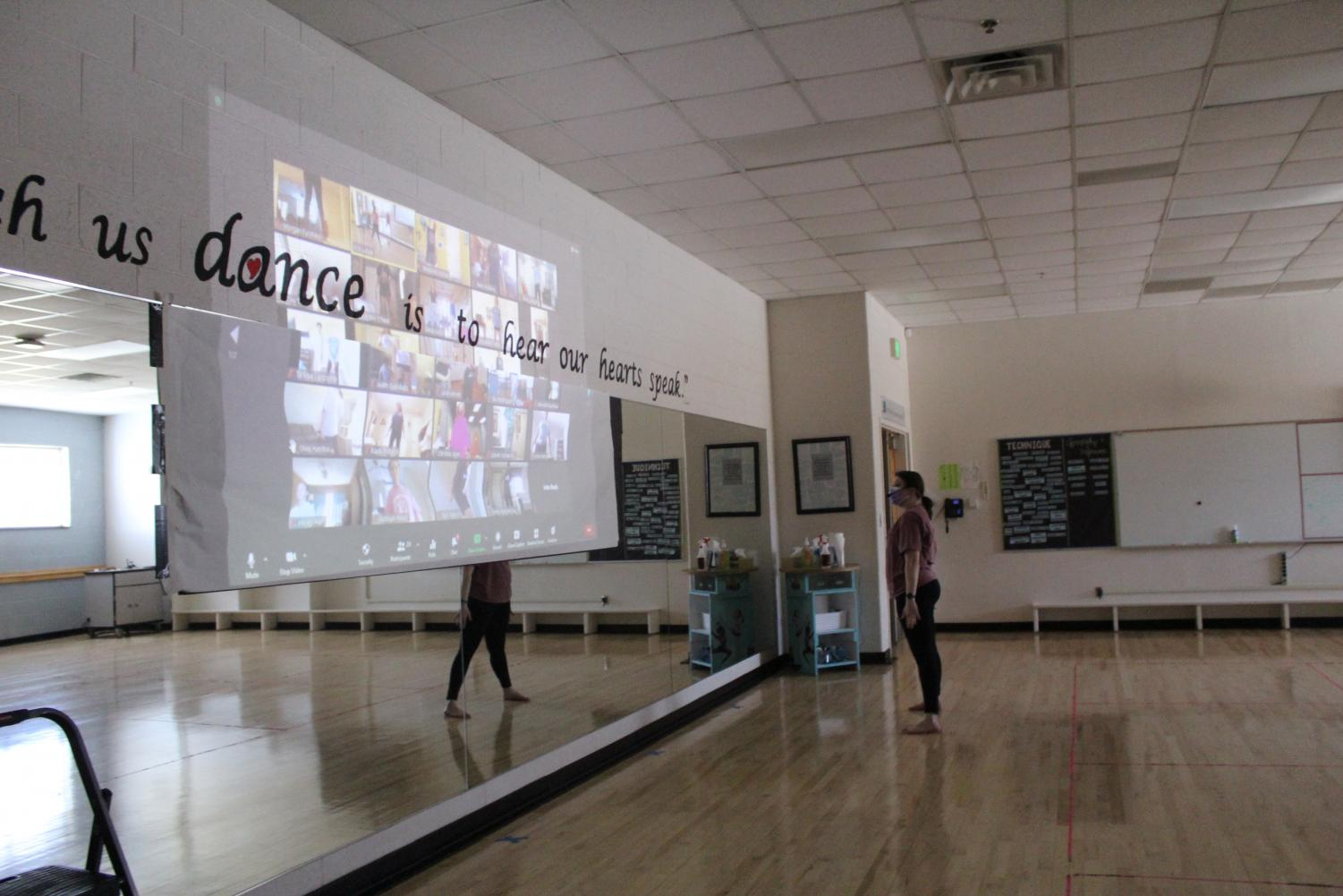 Reagan dance teacher Erin Astuto teaches a virtual dance class in the studio. The change in PE requirements will begin for the 2021-22 school year.