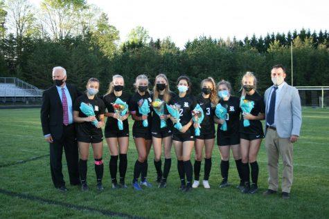 All of the seniors on the Reagan girls Varsity soccer team smile for a picture. The team won the game against Glenn 10-1.