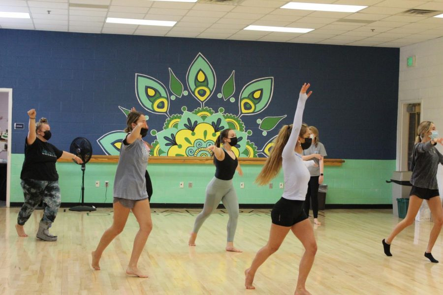 Students practice a routine in Molly Harwells Dance 3/4 class. All students and staff are required to wear masks while indoors per COVID-19 guidelines.