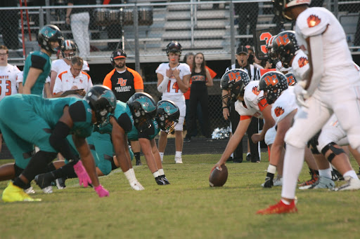 The Reagan Raiders and the Davie War Eagles line up for a play at the Reagan homecoming game on Friday Sept. 17. The Raiders would go on to win 56-14.